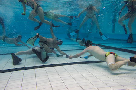 Underwater hockey player fighting for the puck